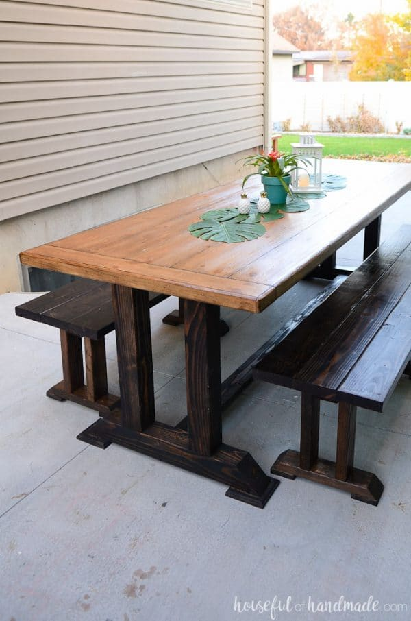 Create the perfect entertaining space with these outdoor dining table plans. A large picnic table with benches is a wonderful way to enjoy dinner outside with your guests. Housefulofhandmade.com