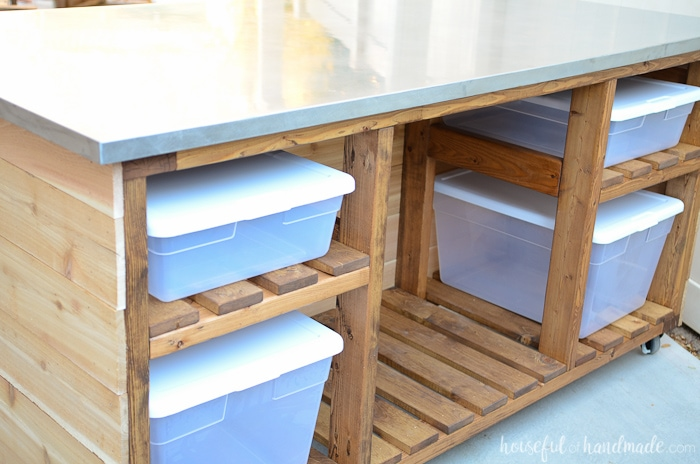 I love this beautiful outdoor kitchen island. There is so much storage for all your barbecue and outdoor cooking gear. Get the free build plans on Housefulofhandmade.com