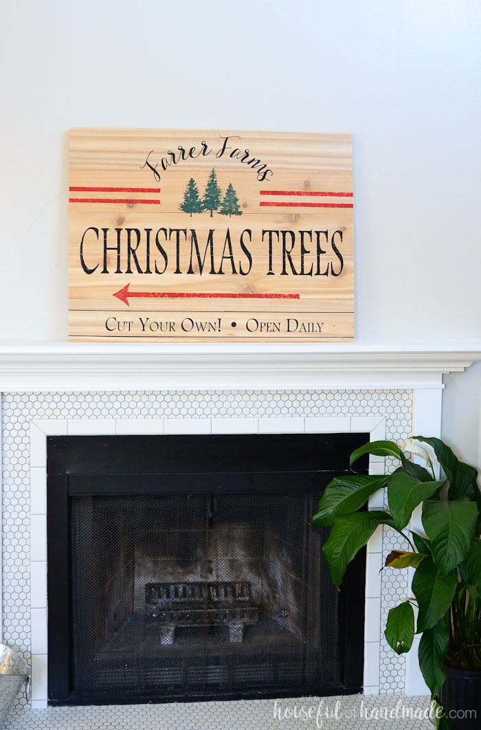 It's the beginning of our Christmas mantel. I love this easy DIY Christmas tree farm sign. Housefulofhandmade.com