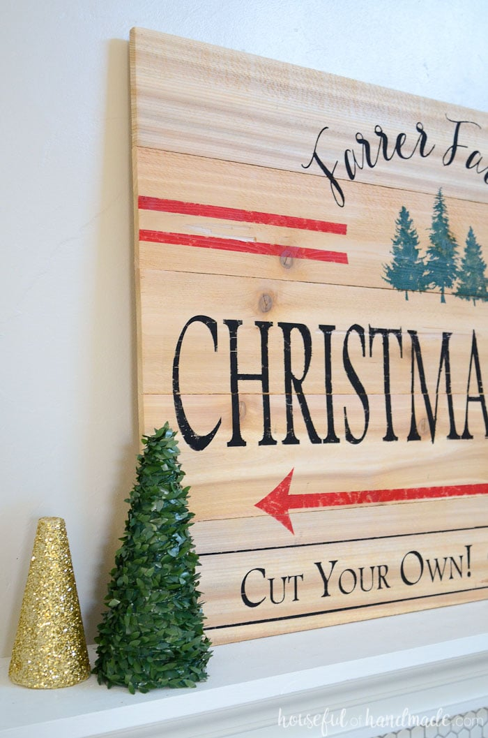 I love the idea of a mantel full of Christmas trees! This Christmas tree farm sign is the perfect centerpiece for it. Housefulofhandmade.com