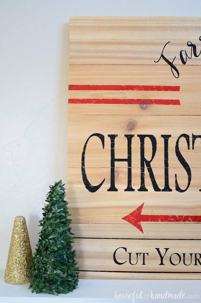 This vintage inspired Christmas tree farm sign is an easy and inexpensive way to add Farmhouse Christmas charm to your home. Build the perfect farmhouse Christmas decor with budget fence pickets. Housefulofhandmade.com