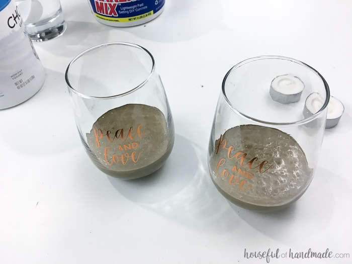These beautiful stemless wine glasses were turned into rustic tea light candle holders. Housefulofhandmade.com
