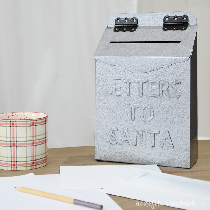 Paper Christmas decor idea: A Letters to Santa mailbox made from an upcycled cereal box on a table.