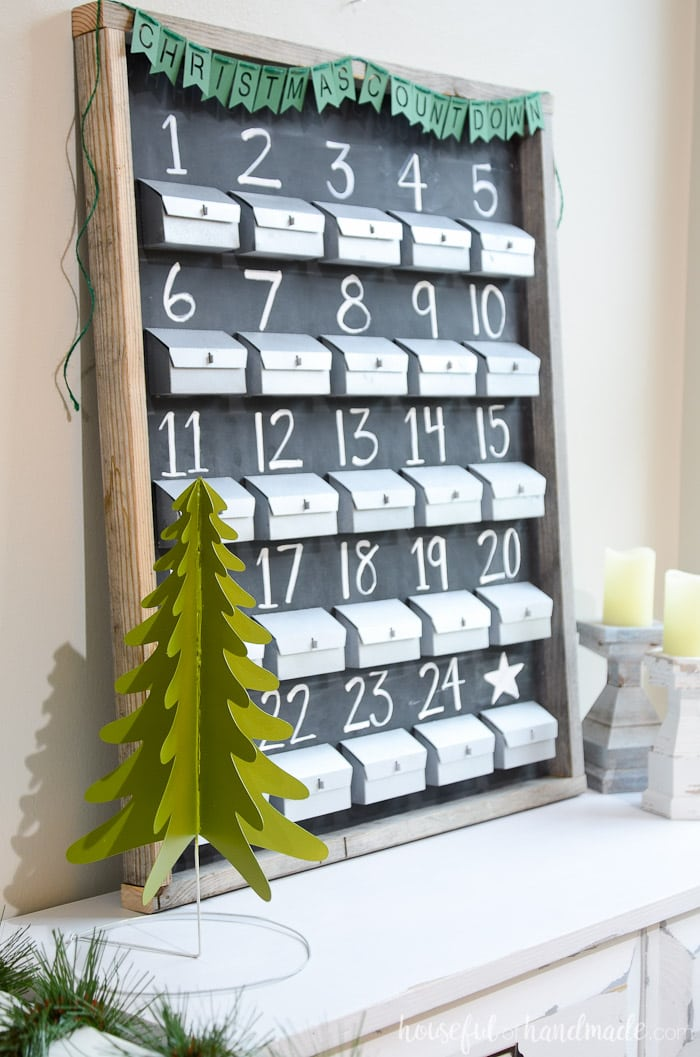 This paper advent calendar is gorgeous! I love the chalkboard and refillable advent calendar boxes. Get the tutorial from Housefulofhandmade.com.