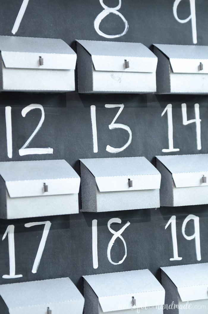 Create a rustic advent calendar with these cute paper advent boxes that look like metal mailboxes. Perfect farmhouse Christmas decor. Housefulofhandmade.com
