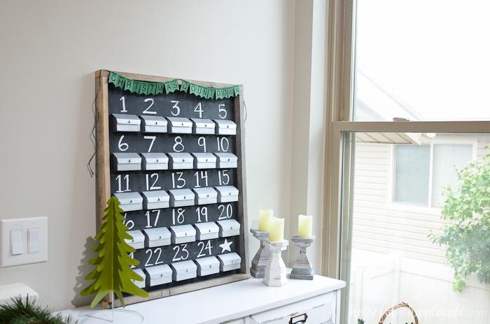 I love this DIY advent calendar. Make refillable paper advent calendar boxes to create a beautiful rustic advent calendar. Housefulofhandmade.com