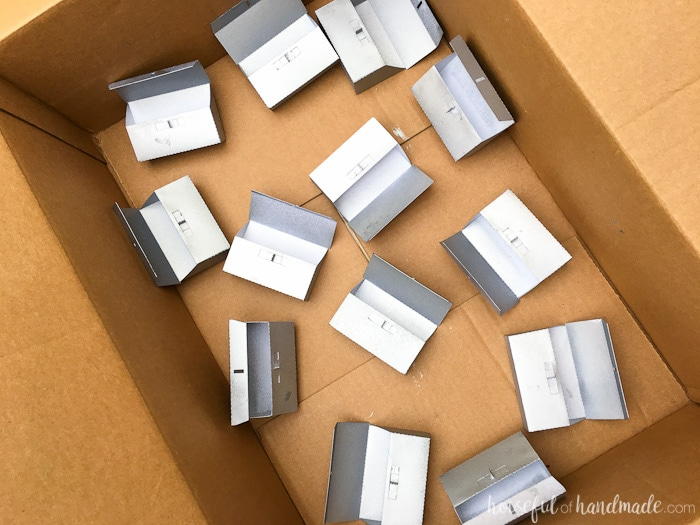 Spray paint the assembled advent calendar boxes to make them look like metal. Housefulofhandmade.com