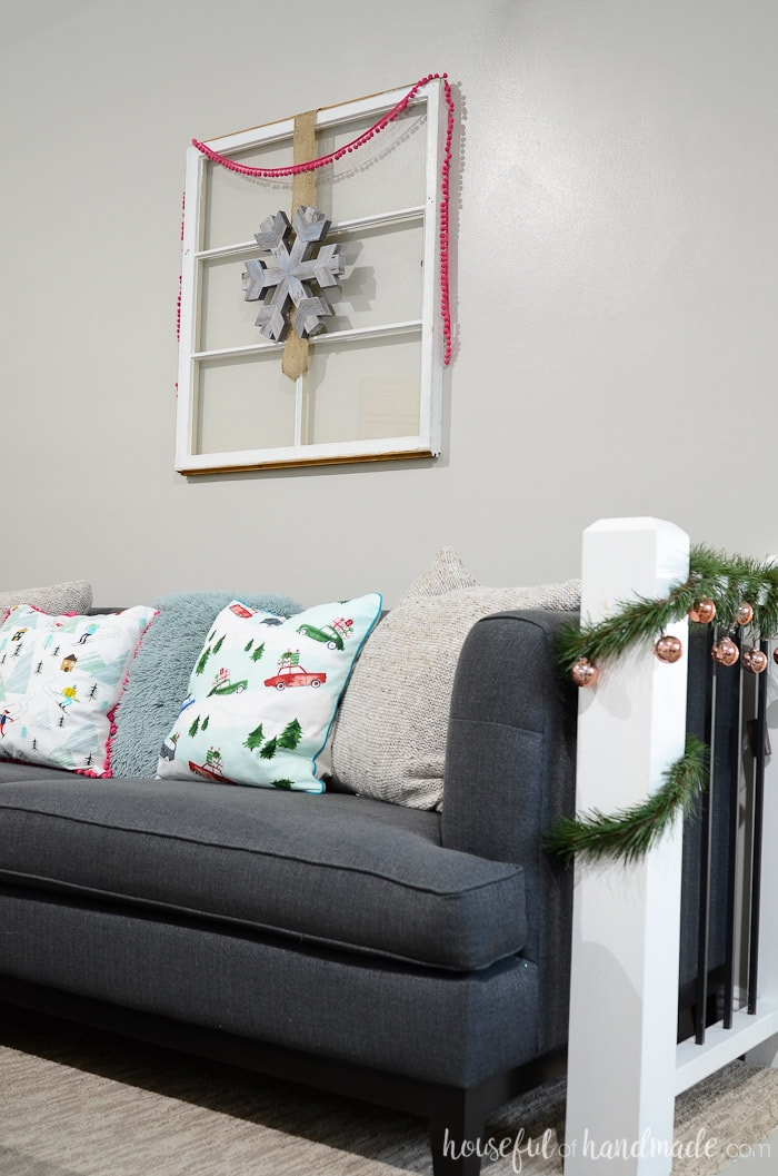 Rustic Christmas decor doesn't have to be all neutral. See how we added pops of jewel tone colors to our home. Housefulofhandmade.com