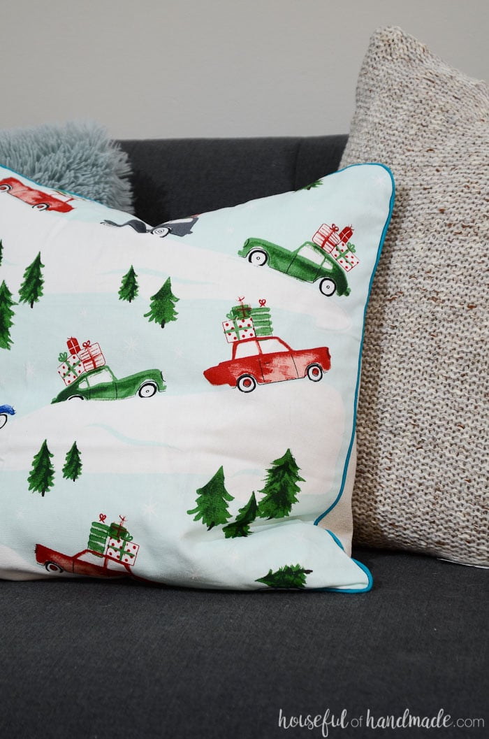Create whimsical Christmas pillows from printed dish towels. These are perfect for the jewel toned Christmas decor. Housefulofhandmade.com