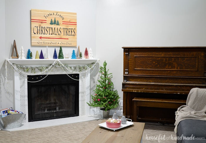 See how we created this beautiful rustic jewel tone Christmas decor in our living room home tour. Farmhouse style and a touch of whimsy is the perfect way to decorate for the holidays. Housefulofhandmade.com