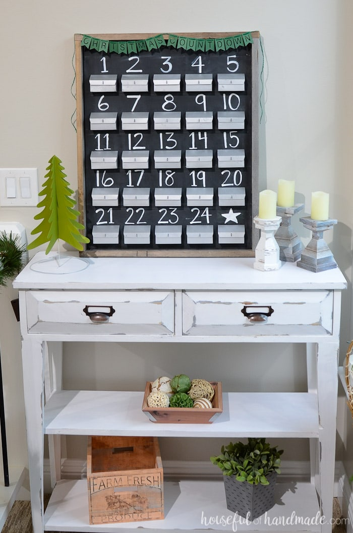 Count down to Christmas with a refillable advent calendar. Its the perfect rustic Christmas decor idea. Housefulofhandmade.com
