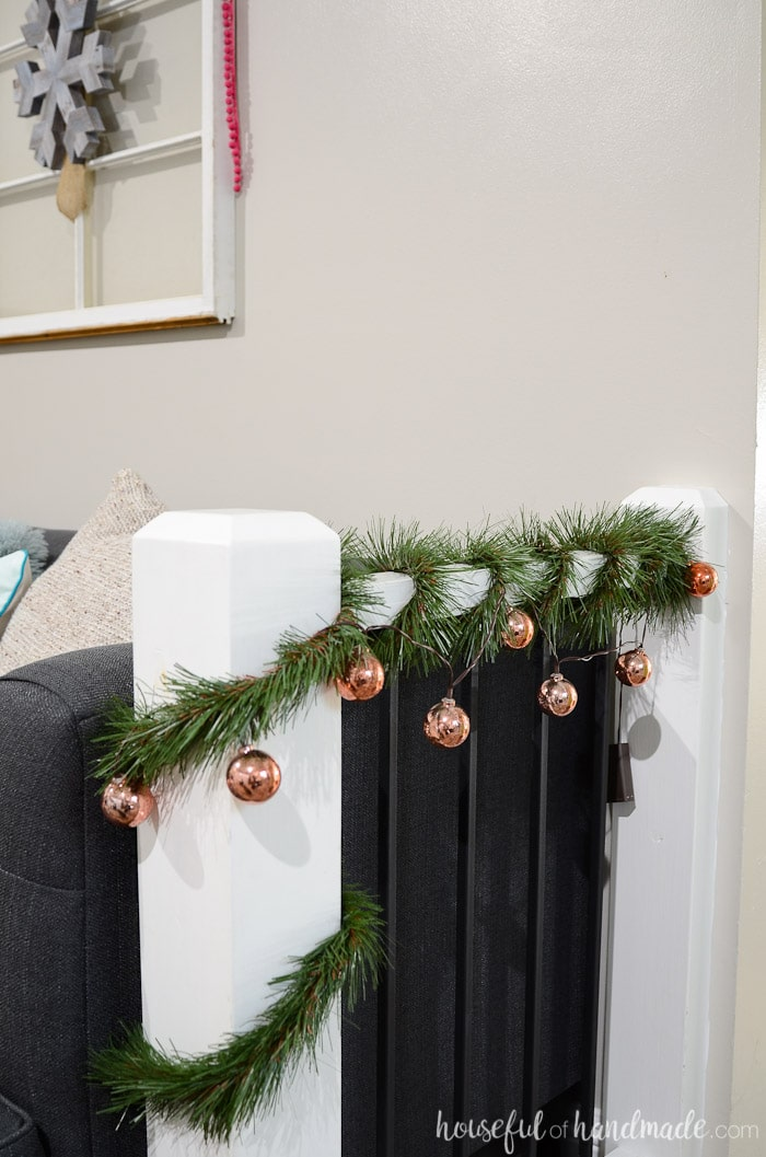 Add simple garland to your railings to get ready for Christmas. See the rest of the Christmas living room tour on Housefulofhandmade.com.