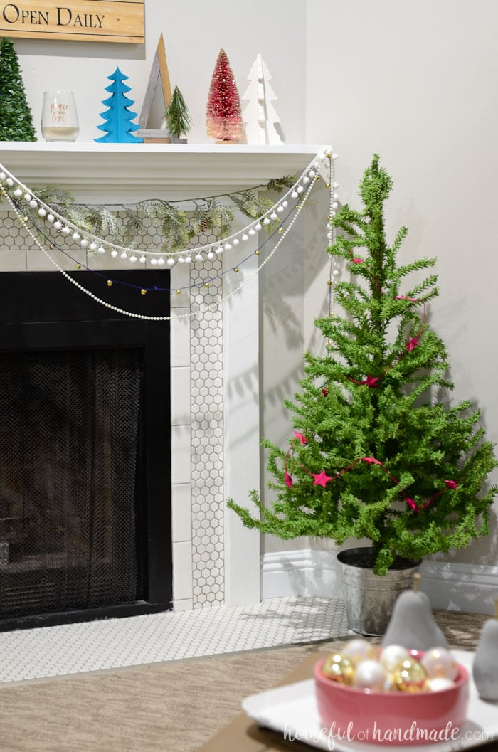 Create a beautiful rustic Christmas with touches of whimsy with this Rustic Jewel tone Christmas decor. See how we got our living room ready for the holidays in this Christmas living room tour. Housefulofhandmade.com