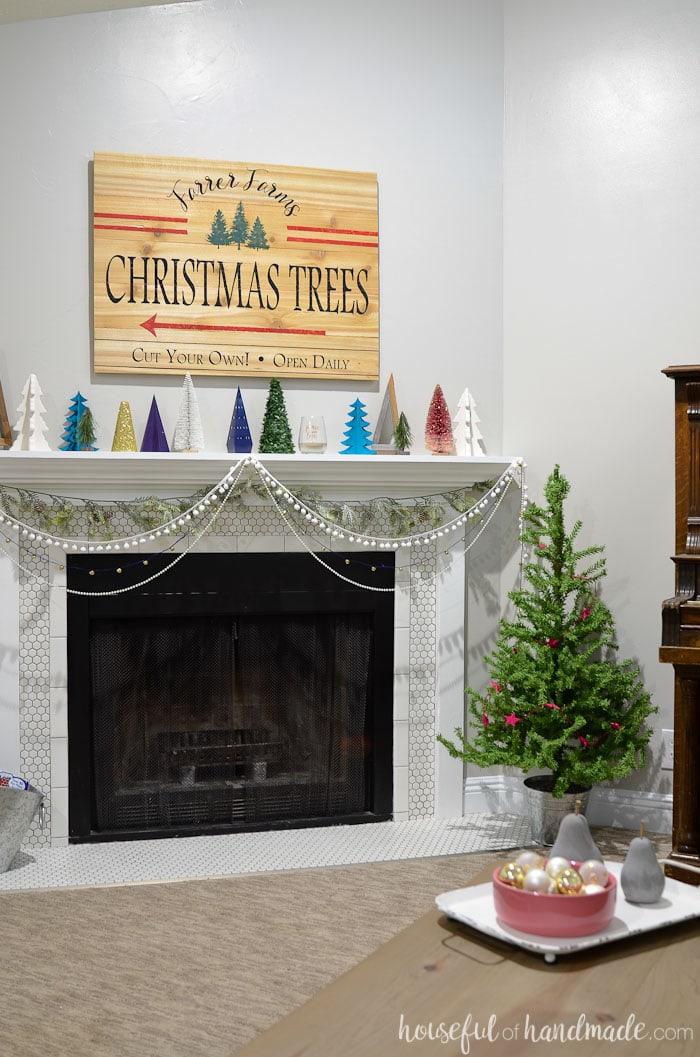 Whimsy and farmhouse meet in this beautiful living room Christmas home tour. Rustic jewel tone Christmas decor is paired with cozy creams for the perfect blend. Housefulofhandmade.com