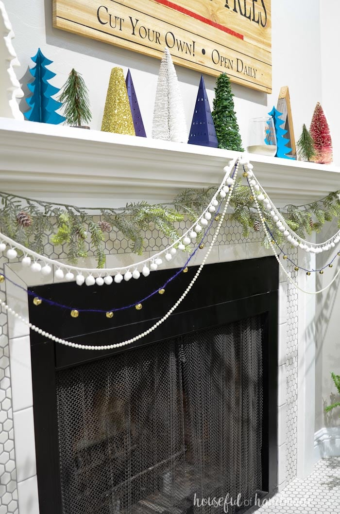 Add garland below the mantel to add texture and greenery without cluttering up the top of the mantel. Christmas home tour from Housefulofhandmade.com.