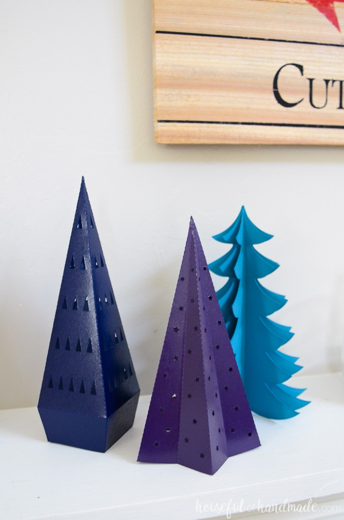 These paper Christmas trees are the perfect way to add Christmas decor on a budget. They are perfect on our holiday mantel. Housefulofhandmade.com