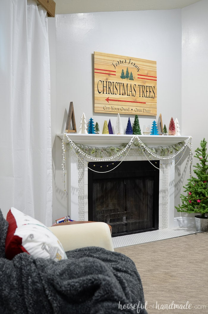 See how we decorated our holiday mantel with lots of DIY projects. And get lots of Christmas mantel inspiration with all the beautiful mantels in this series. Housefulofhandmade.com