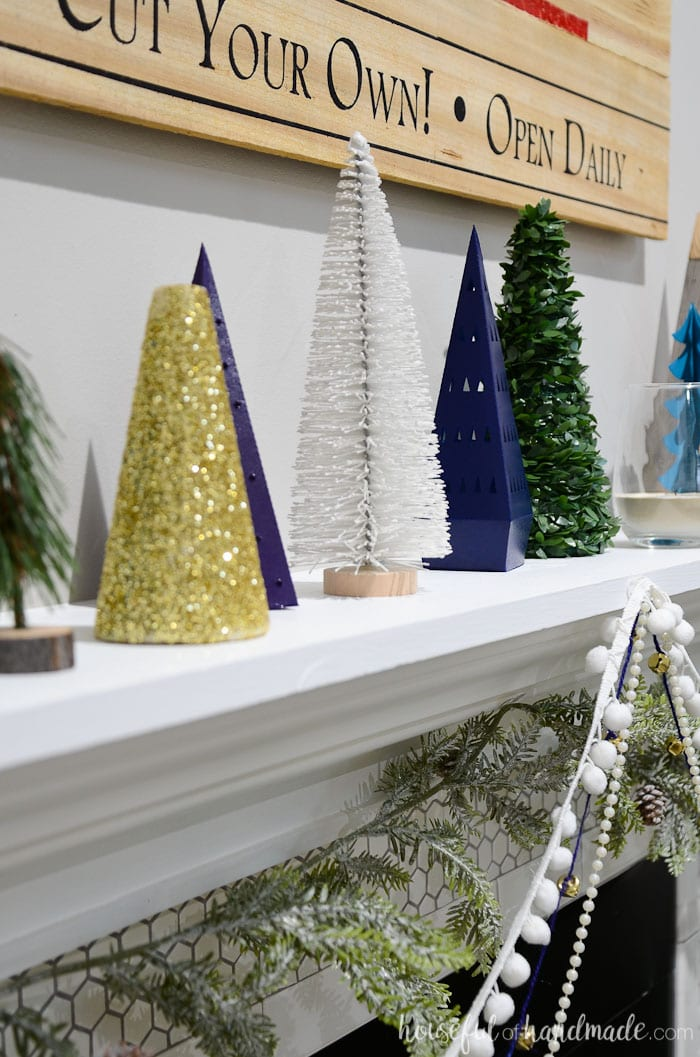 Discover new ways to decorate your mantel for Christmas with this fun decor series. See how we created a Christmas tree farm holiday mantel on a budget. Housefulofhandmade.com