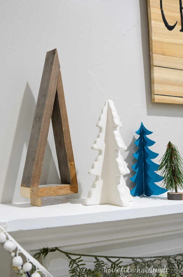 I love these reclaimed wood Christmas trees. The entire Christmas tree farm mantel is beautiful. Housefulofhandmade.com