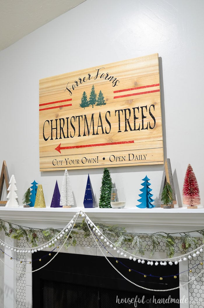 DIY a big wood sign on a budget from cedar fence pickets. It's the perfect centerpiece for this holiday mantel. Housefulofhandmade.com