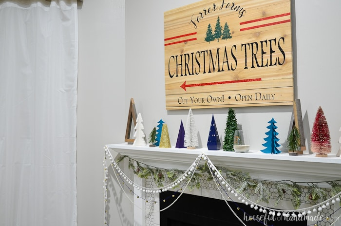 Create a beautiful holiday mantel full of Christmas trees. Housefulofhandmade.com