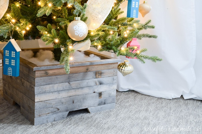 Instead of a tree skirt, create a tree planter out of reclaimed wood. This box is beautiful. Housefulofhandmade.com