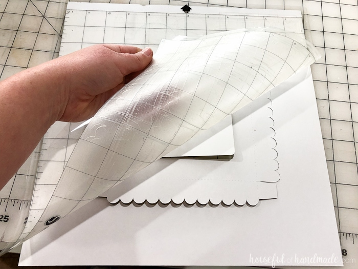 Tip for removing paper from a sticky cutting mat. Housefulofhandmade.com