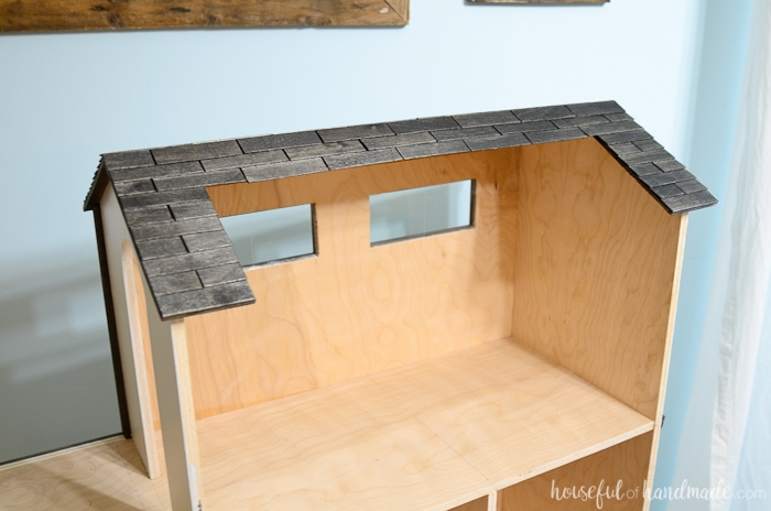 I love the roof on this country cottage dollhouse. It's made out of inexpensive paint stir sticks. Housefulofhandmade.com