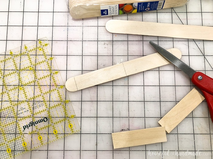 These extra large popsicle sticks are the perfect roof for our handmade dollhouse exterior. Housefulofhandmade.com