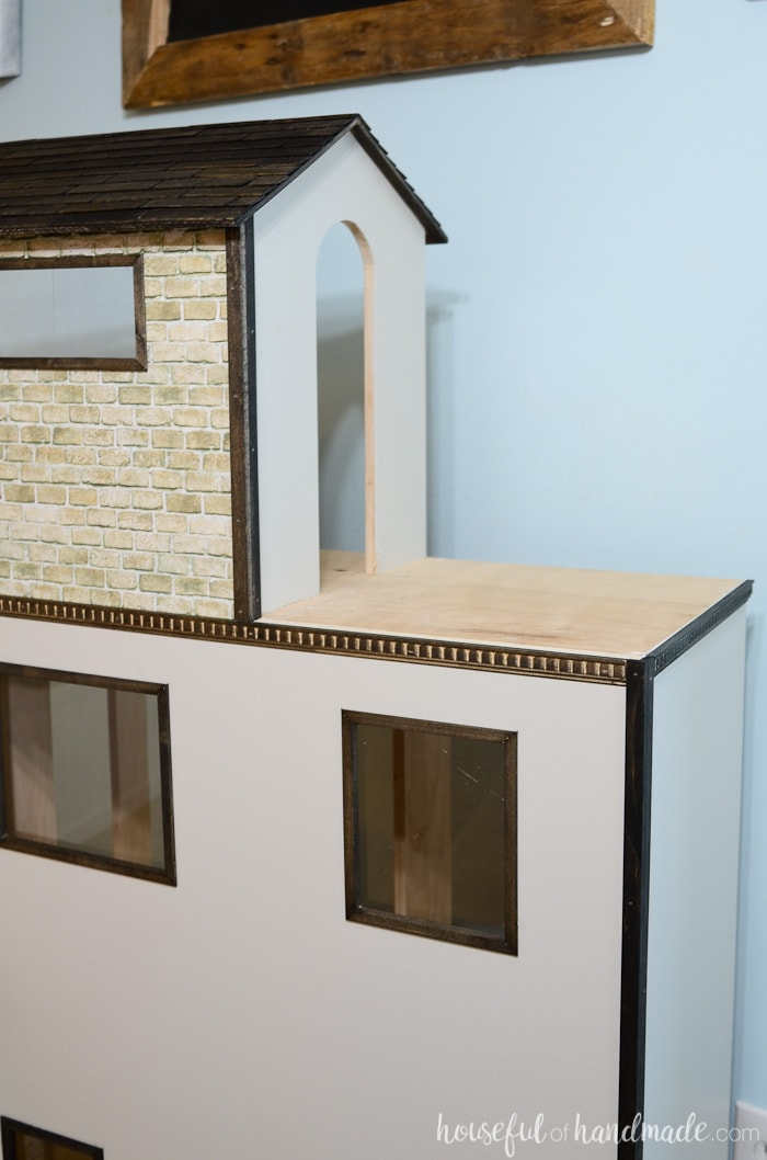How cute is this dollhouse exterior!? I love the trim detail, faux brick, and plexiglass windows. Housefulofhandmade.com