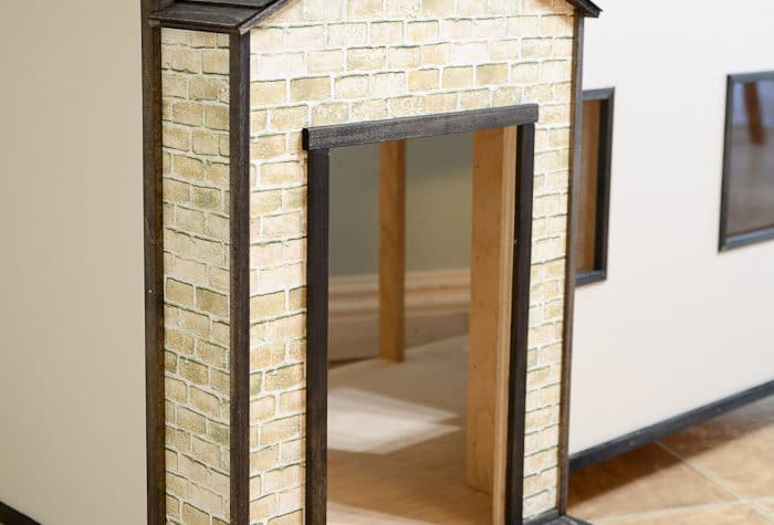 Get the look of this handmade dollhouse exterior on a budget. Such easy dollhouse decorating ideas. Housefulofhandmade.com