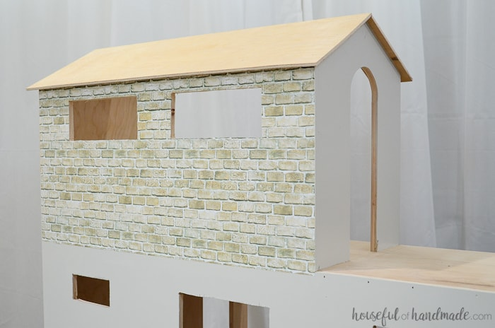 I love the brick on this handmade dollhouse. Get the free build plans at Housefulofhandmade.com.