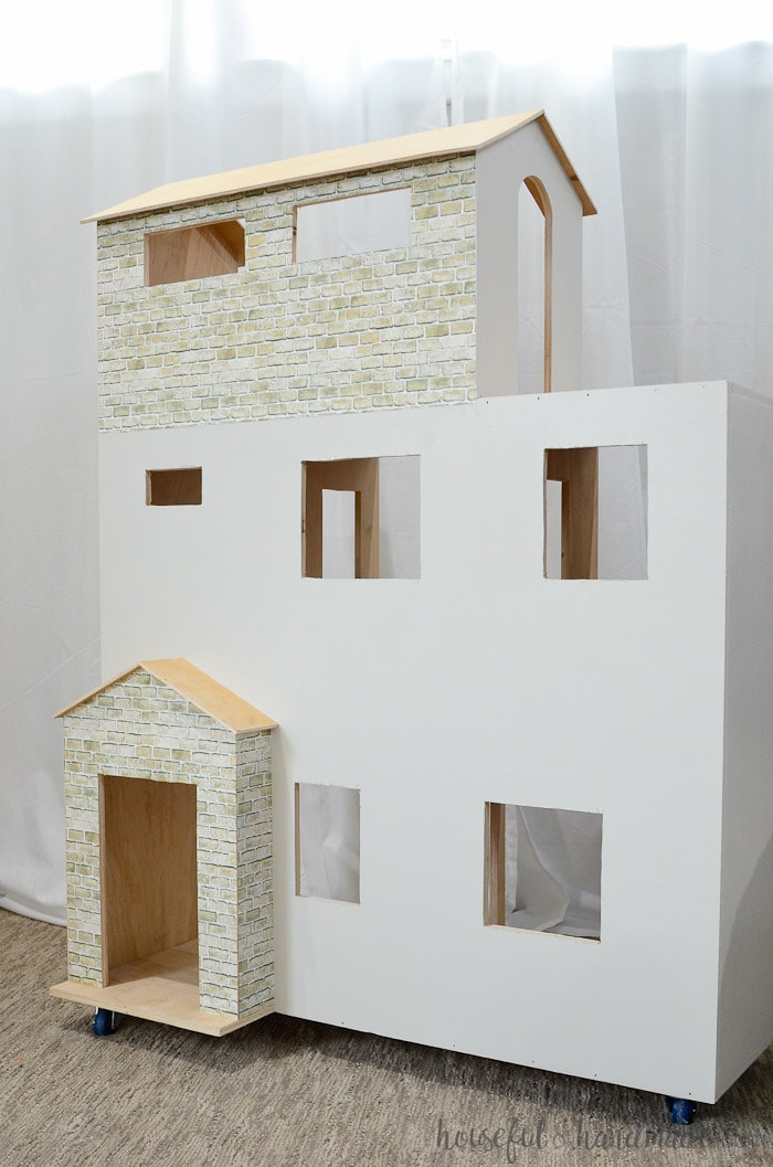 DIY Handmade plywood dollhouse in white with faux brick
