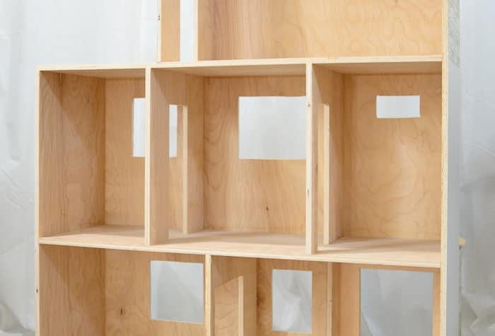 Handmade dollhouse made out of plywood. Housefulofhandmade.com