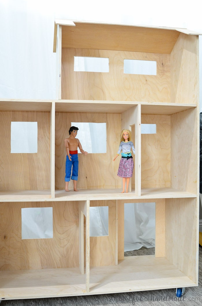 Rolling handmade dollhouse shown with two barbies