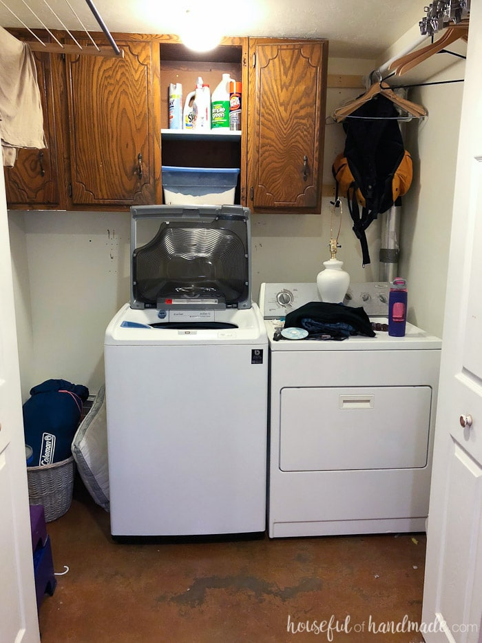 Before photo of the colorful farmhouse laundry room makeover.