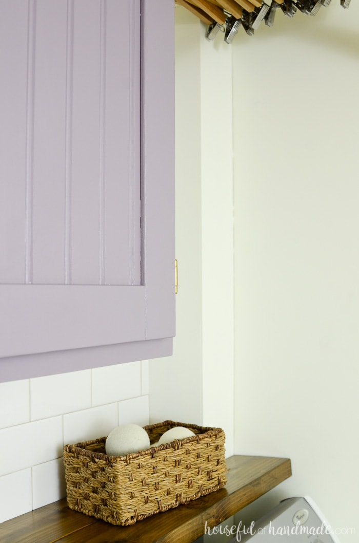 Farmhouse laundry room with purple cabinets and barnwood shelf. Housefulofhandmade.com