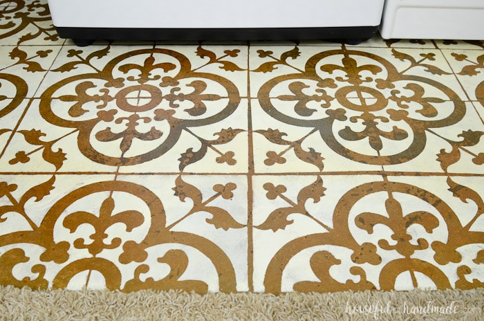 Cement floor with stenciled tile pattern on it in the farmhouse laundry room. Housefulofhandmade.com