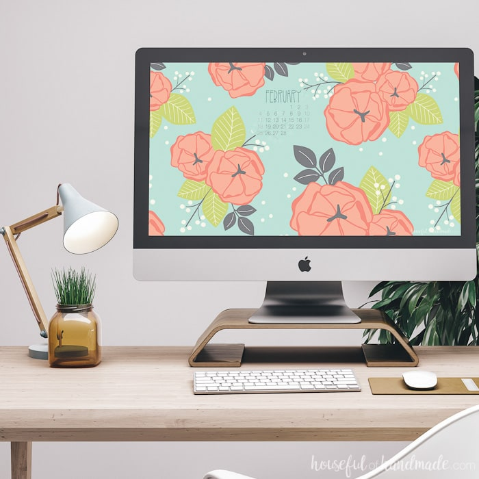 Free digital wallpaper for February on a desktop computer next to a lamp. Housefulofhandmade.com