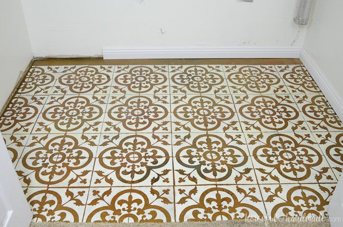 Transform your floor on a budget with a floor stencil. You can create a beautiful patterned tile design for a huge impact in any room. See how easy it is to paint a floor stencil with this easy tutorial. Housefulofhandmade.com
