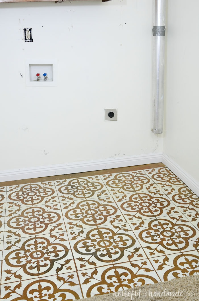 It's so easy and inexpensive to transform a floor with a floor stencil. See how we turned out laundry room floor into a masterpiece for only $19. Housefulofhandmade.com