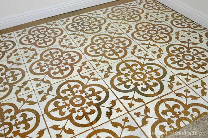 Learn how to paint a floor stencil to create a beautiful patterned tile look on a budget. Housefulofhandmade.com