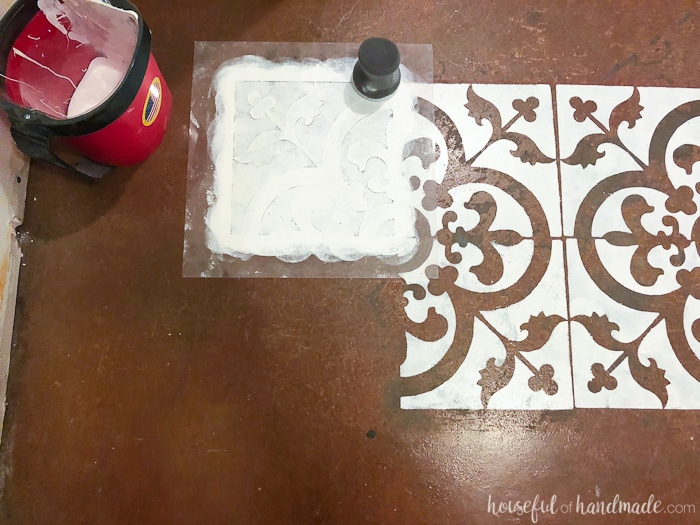 Keep painting the floor stencil all over the floor to create a complete pattern. Housefulofhandmade.com