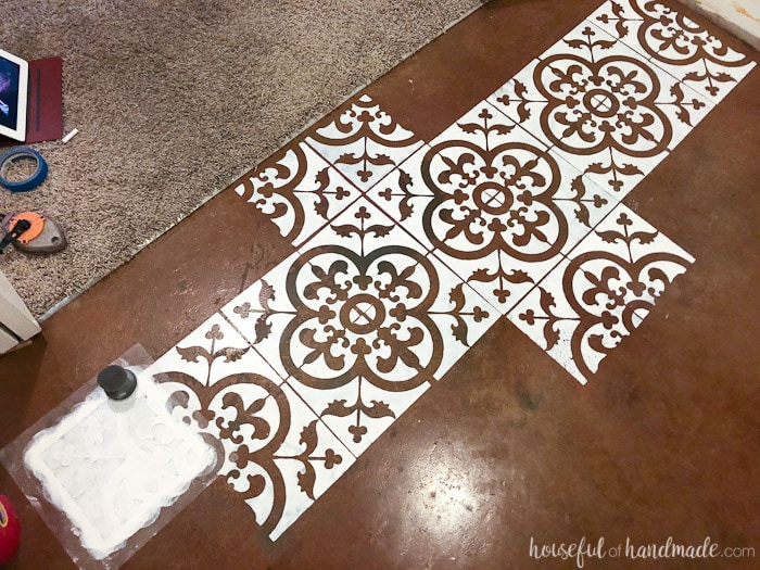 I love this floor stencil! It looks like painted concrete tiles. See the complete transformation at Housefulofhandmade.com.