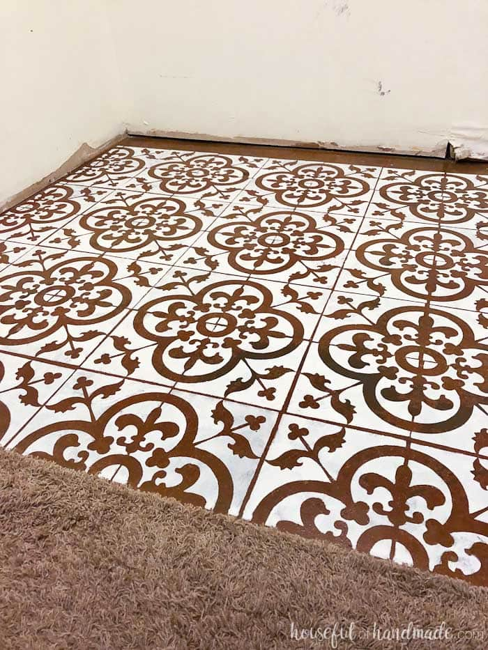 Add a faux patterned tile to your floor with a floor stencil. Housefulofhandmade.com