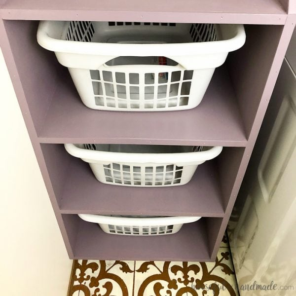 Turn an outdated and boring laundry room into a beautiful modern farmhouse laundry room with only $100. Housefulofhandmade.com