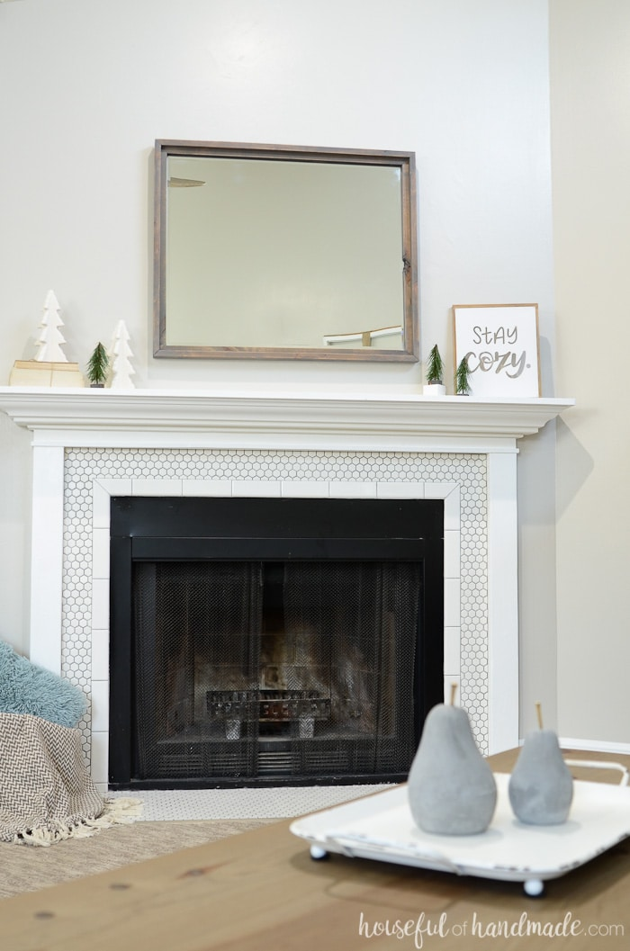 Beautiful simple farmhouse mantel from Housefulofhandmade.com.