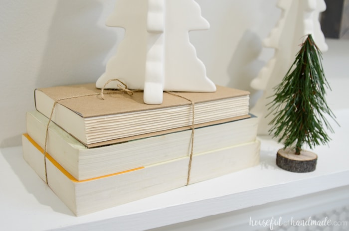 Use some books turned backward to add height to elements on your mantel. Housefulofhandmade.com