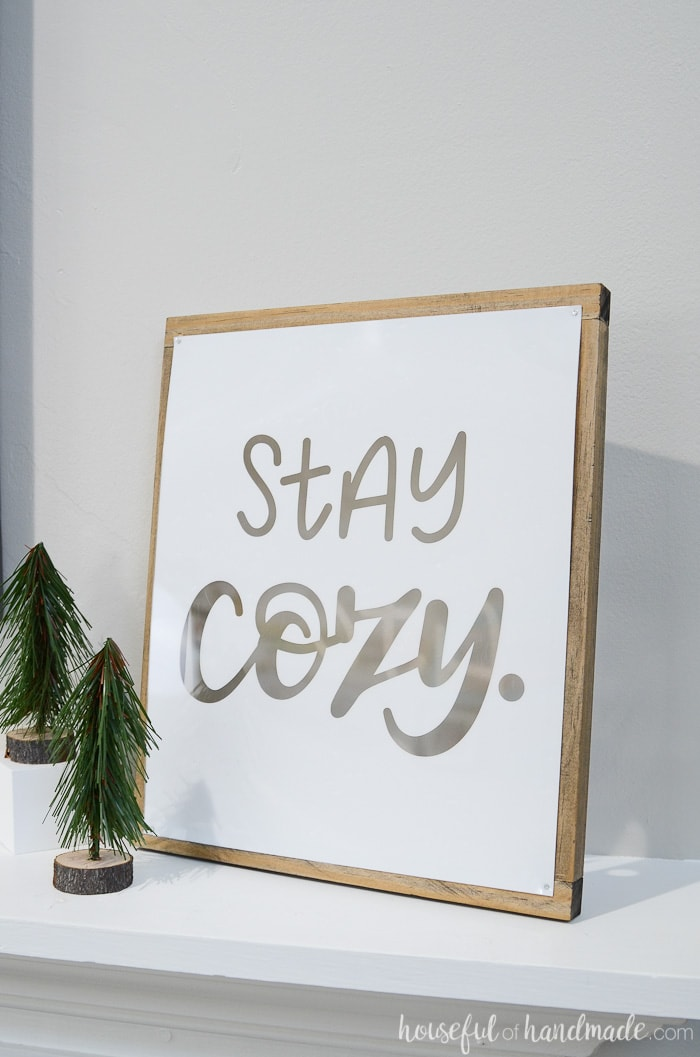 Create a simple white sign to add a touch of whimsy to your farmhouse winter mantel. Housefulofhandmade.com