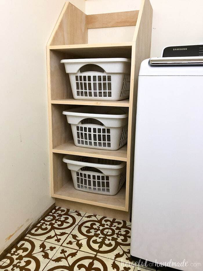 Use these amazing DIYs to Organize your home this year. Organize your laundry room with this stackable laundry basket storage. This easy to build shelf unit is the perfect laundry basket organizer so you can keep your dirty laundry hidden. Get the build plans from Housefulofhandmade.com.